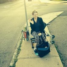 At the bus stop (L.E. Swenson)